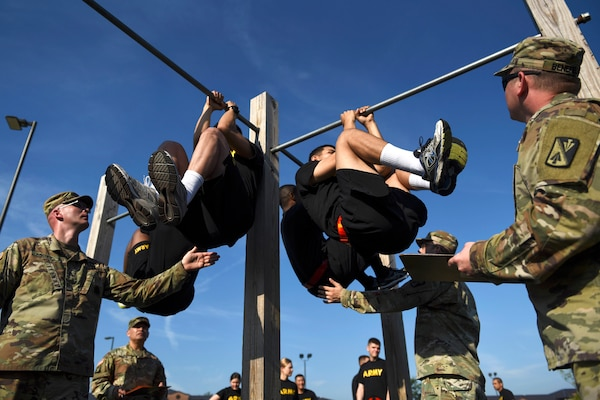 U.S. Army Advanced Individual Training students perform leg tucks during an Army Combat Fitness Test at Joint Base Langley-Eustis, Virginia, June 28, 2019. Leg tucks are the fifth event in the ACFT as it is a test of endurance that requires Soldiers to complete as many repetitions as possible in two minutes.