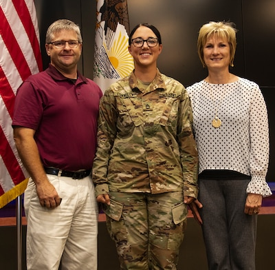 Sgt. 1st Class Erin Connelly, joined by sister, Candy Jansen, and brother-in-law, Larry Jansen, was promoted to her current rank Sept. 4 at the Illinois Military Academy, Camp Lincoln, Springfield, Illinois.