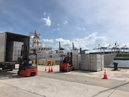 Coast Guard cutters at Coast Guard Sector Miami onload hurricane relief supplies to take to the Bahamas.