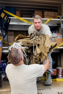 U.S. Air Force Tech. Sgt. Shane Kilgore, a heavy equipment operator with the 116th Civil Engineer Squadron, Georgia Air National Guard, removes supplies from a route clearance package during an inventory of the package at Fort Stewart, Ga., in preparation for Hurricane Dorian response Sept. 4, 2019.