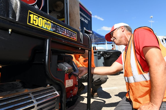 Steve Isaacs, a driver for Foster Fuels, performs maintenance on a power generator staged at Robins Air Force Base, Georgia, Sept. 3, 2019, in support of emergency response to Hurricane Dorian.