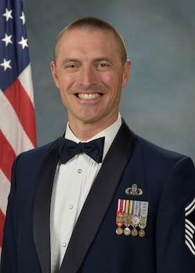 Official photo of SMSgt. David McCormick, trombone with the Concert Band and the Falconaires, two of nine ensembles in the United States Air Force Academy Band, Peterson Air Force Base, Colorado.
