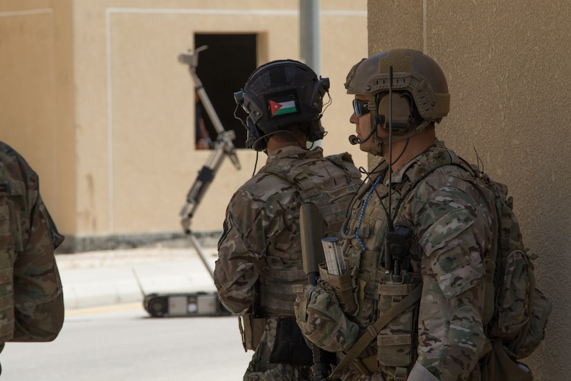 U.S. Army Special Operations Task Force and Jordan Armed Forces, along with a JAF Explosive Ordnance Disposal unit, conduct site exploitation of a notional downed unmanned aerial vehicle Sept. 2, 2019, at the King Abdullah II Special Operations Training Center in Amman, Jordan, during Exercise Eager Lion 19. Eager Lion, U.S. Central Command's largest and most complex exercise, is an opportunity to integrate forces in a multilateral environment, operate in realistic terrain and strengthen military-to-military relationships.