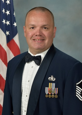 Official photo of MSgt. Christopher Hammiel, trumpet with the Concert Band and the Falconaires, two of nine ensembles in the United States Air Force Academy Band, Peterson Air Force Base, Colorado.