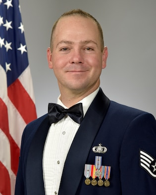 Official photo of SSgt. Andrew Fowler, trumpet with the Concert Band and The Falconaires, two of nine ensembles in the United States Air Force Academy Band, Peterson Air Force Base, Colorado.