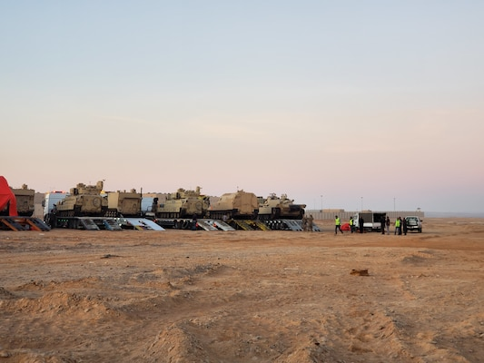 The 858th Movement Control Team oversees the loading of Task Force Spartan's equipment onto host nation trucks for transportation to their training destination during Eager Lion.