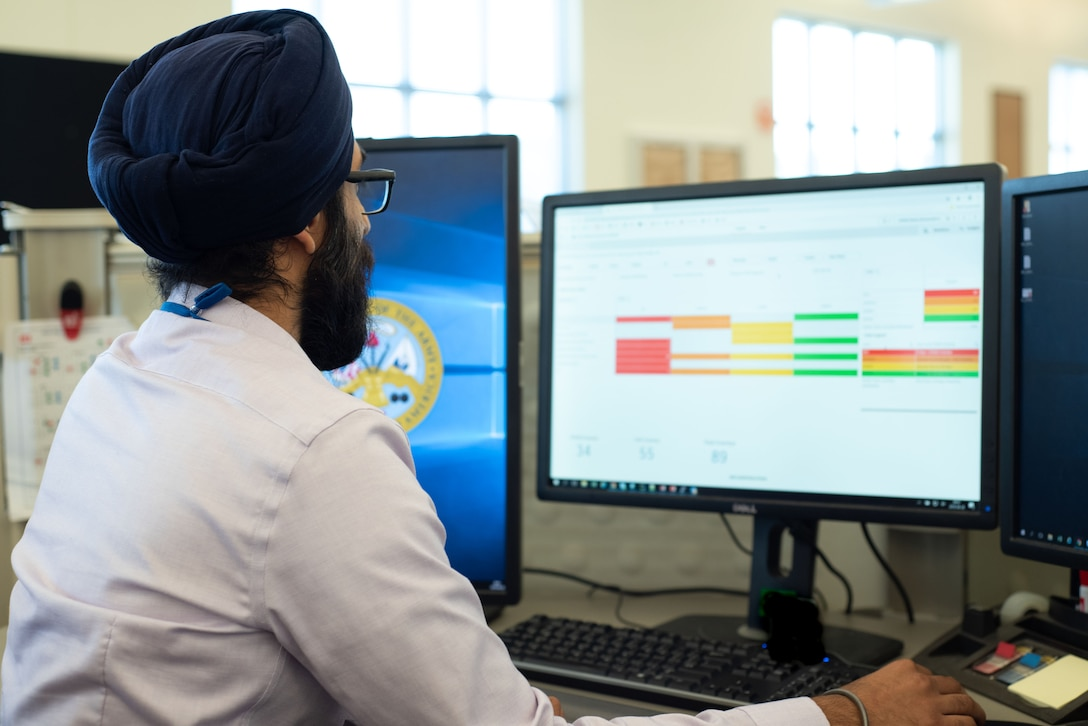 Manveer Singh Khanijoun, a business data analyst with Business Practices at the U.S. Army Engineering and Support Center, Huntsville, Alabama, navigates a Qlik Sense dashboard Aug. 28, 2019, as part of Huntsville Center's push to incorporate data analytics, visualization and automation into its everyday processes.