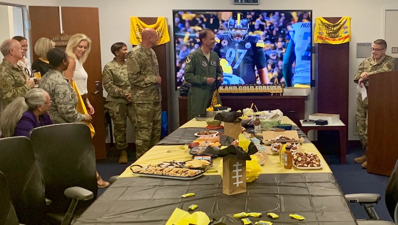 Staffers and family members gathered Sept. 5 for a Pittsburgh Steelers-themed send off at Air Force District of Washington headquarters in honor of outgoing Vice Commander Col. Kevin Eastland.