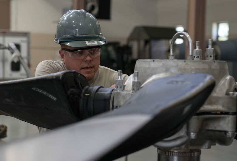 Tech. Sgt. Steve Lew, an aerospace technician assigned to the to the 910th Maintenance Squadron, assembles the hub and blades on test post, Aug. 11, 2019 at Youngstown Air Reserve Station.