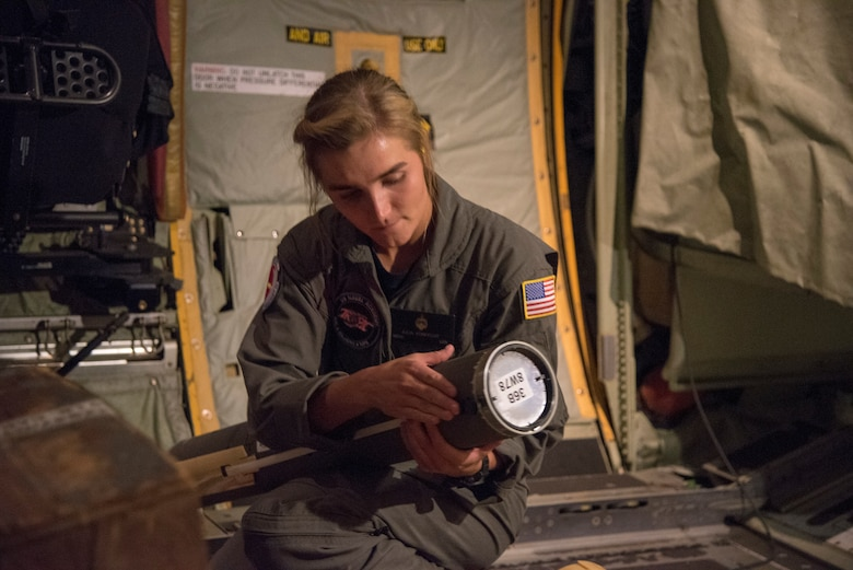 U.S. Naval Academy Midshipman First Class Julia Von Fecht, Training and Research in Oceanic and Atmospheric Processes in Tropical Cyclones Program team member, prepares a Navy Airborne Expendable Bathythermographs for deployment from a WC-130J Super Hercules during a Hurricane Hunter mission into Hurricane Dorian Aug. 31, 2019 over the Atlantic Ocean.