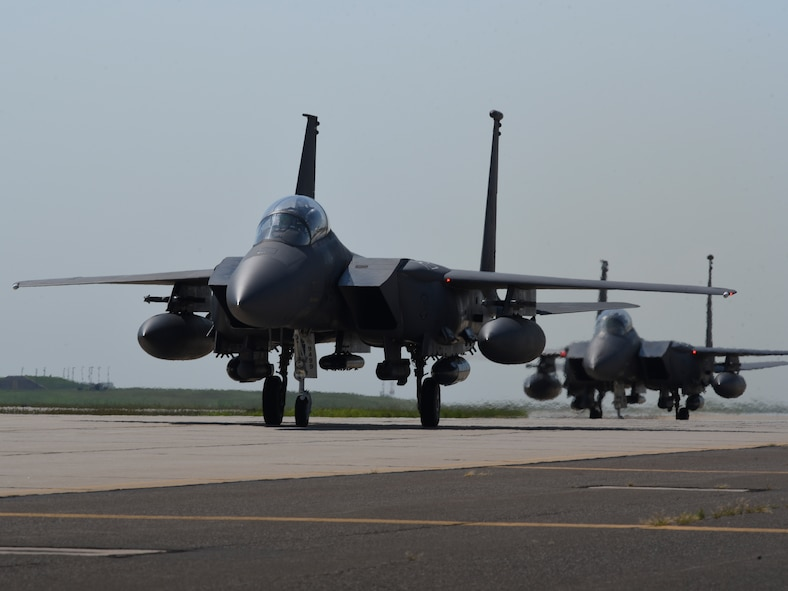Three F-15E Strike Eagle aircraft from the 4th Fighter Wing, Seymour-Johnson Air Force Base, North Carolina, taxi at Tinker AFB, Oklahoma as part of a mass-relocation of vulnerable aircraft to escape Hurricane Dorian's path Sept. 4, 2019, Tinker AFB, Oklahoma. Team Tinker executed an existing agreement with Seymour-Johnson AFB, North Carolina and Warner-Robins AFB, Georgia to host fighters, tankers and reconnaissance aircraft far away from the devastating hurricane currently impacting the East Coast of the United States. (U.S. Air Force photo/Greg L. Davis)