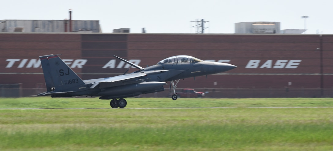 An F-15E Strike Eagle aircraft from the 4th Fighter Wing, Seymour-Johnson Air Force Base, North Carolina, lands with its airbrake deployed at Tinker AFB, Oklahoma as part of a mass-relocation of vulnerable aircraft to escape Hurricane Dorian's path Sept. 4, 2019, Tinker AFB, Oklahoma. Team Tinker executed an existing agreement with Seymour-Johnson AFB, North Carolina and Warner-Robins AFB, Georgia to host fighters, tankers and reconnaissance aircraft far away from the devastating hurricane currently impacting the East Coast of the United States. (U.S. Air Force photo/Greg L. Davis)