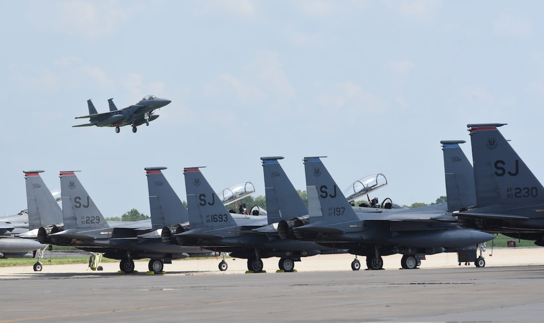 An F-15E Strike Eagle from the 4th Fighter Wing, Seymour-Johnson Air Force Base, North Carolina, on final approach to Tinker AFB, Oklahoma with other Strike Eagles parked in the foreground during a mass-relocation of vulnerable aircraft to escape Hurricane Dorian's path Sept. 4, 2019, Tinker AFB, Oklahoma. Team Tinker executed an existing agreement with Seymour-Johnson AFB, North Carolina and Warner-Robins AFB, Georgia to host fighters, tankers and reconnaissance aircraft far away from the devastating hurricane currently impacting the East Coast of the United States. (U.S. Air Force photo/Greg L. Davis)