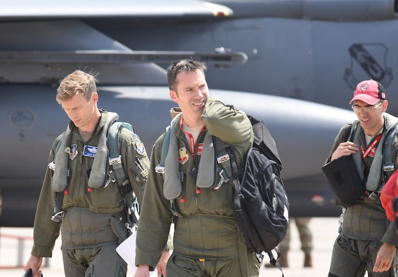 F-15E Strike Eagle aircrew from the 4th Fighter Wing, Seymour-Johnson Air Force Base, North Carolina, walk from the flight line after arriving at Tinker AFB, Oklahoma as part of a mass-relocation of vulnerable aircraft to escape Hurricane Dorian's path Sept. 4, 2019, Tinker AFB, Oklahoma. Team Tinker executed an existing agreement with Seymour-Johnson AFB, North Carolina and Warner-Robins AFB, Georgia to host fighters, tankers and reconnaissance aircraft far away from the devastating hurricane currently impacting the East Coast of the United States. (U.S. Air Force photo/Greg L. Davis)