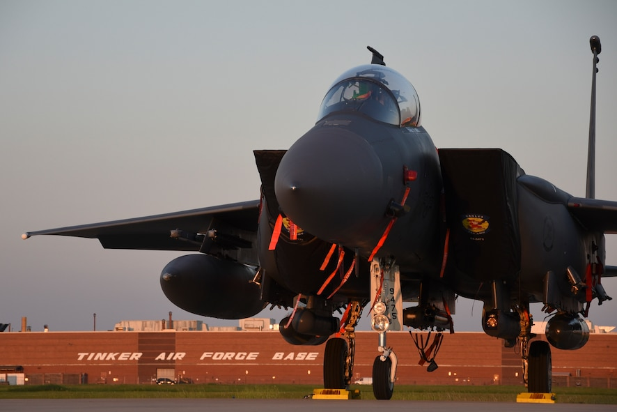 An F-15E Strike Eagle basks in the late evening light after escaping Hurricane Dorian's path and relocating to Tinker Air Force Base, Oklahoma, Sept. 4, 2019. The F-15E is assigned to the 4th Fighter Wing, Seymour-Johnson AFB, North Carolina, as part of Air Combat Command. Team Tinker executed an existing agreement with Seymour-Johnson AFB, North Carolina and Warner-Robins AFB, Georgia to host fighters, tankers and reconnaissance aircraft far away from the devastating hurricane impacting the East Coast of the United States. (U.S. Air Force photo/Greg L. Davis)
