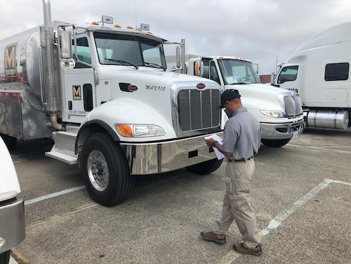 a man checks a fuel truck