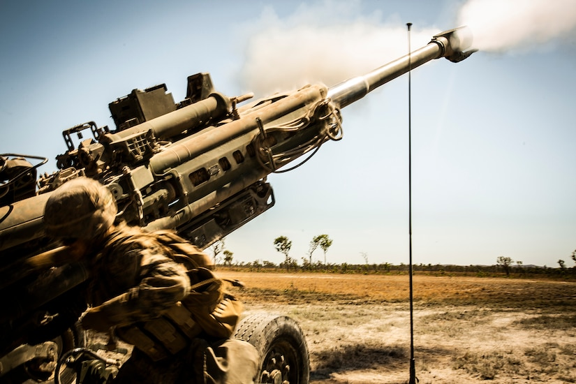 Marines fire a howitzer.