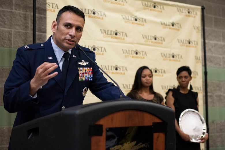 Col. Benjamin Conde, 23d Wing vice commander, speaks on the importance of the military spouse during the Valdosta City Schools (VCS) 2019 Teacher of the Year Banquet Sept. 5, 2019, at the Rainwater Conference Center, Valdosta, Ga. Melvina Murray, 2019 Teacher of the Year Award recipient and Team Moody spouse, received the award for being the system's educator who not only embodies her school's core expectations of integrity first, respect for yourself and others, and excellence in all we do, but also consistently placed her service before herself.  This year the VCS system named Murray as one of two recipients to recognize her hard work and dedication before the Murray family relocates to California mid-September. (U.S. Air Force photo by 2nd Lt. Kaylin P. Hankerson)