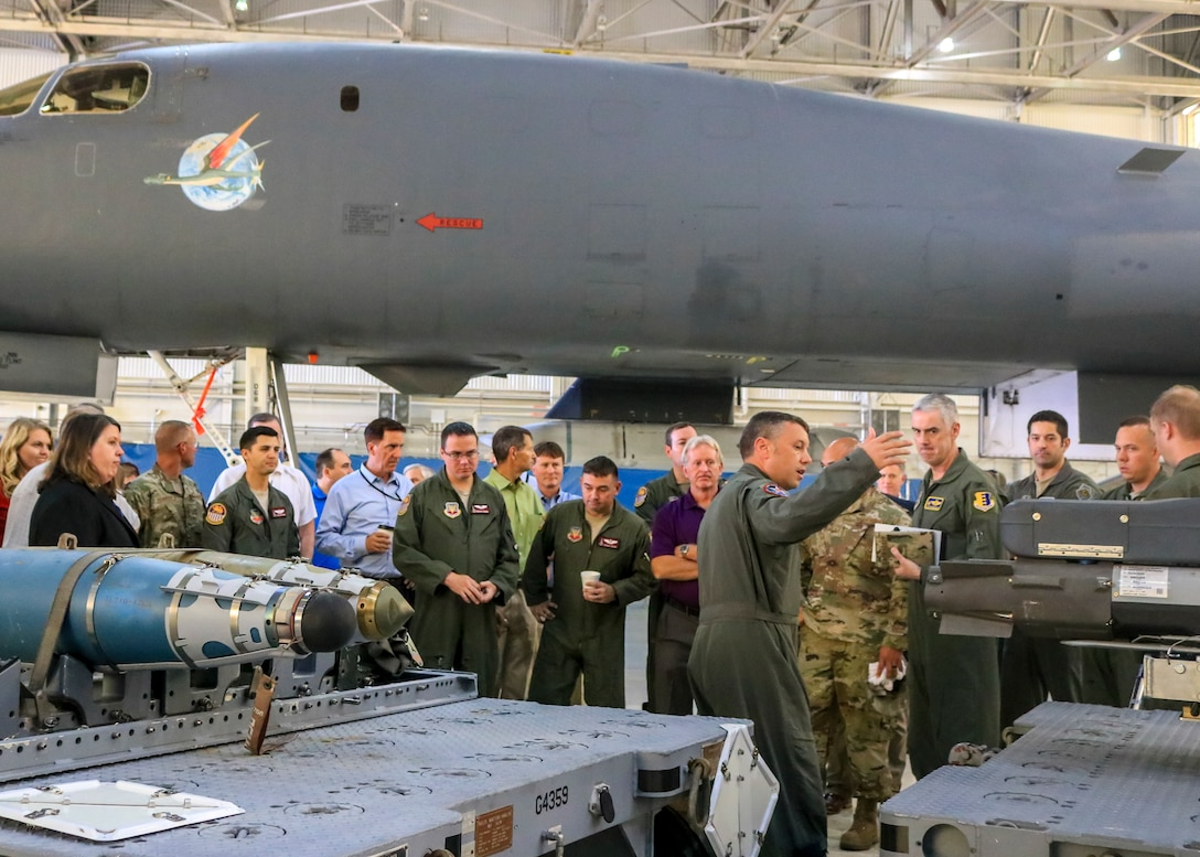 Lt. Col. Dominic Ross, B-1B program element monitor, Air Force Global Strike Command, provides a brief on the expanded weapons load that a new B-1 configuration could carry during a B-1B expanded carriage demonstration at Edwards Air Force Base, California, Aug. 28. (U.S. Air Force photo by Giancarlo Casem)