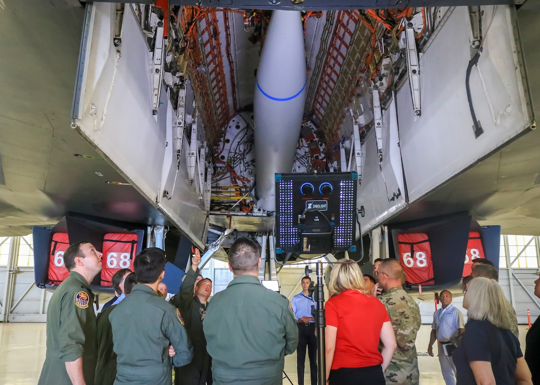 Lt. Col. Dominic Ross, B-1B program element monitor, Air Force Global Strike Command, explains a bulkhead modification to the B-1B bomber that allowed it to carry a notional hypersonic missile mock-up attached to a B-52H Conventional Rotary Launcher during a B-1B expanded carriage demonstration at Edwards Air Force Base, California, Aug. 28. (U.S. Air Force photo by Giancarlo Casem)