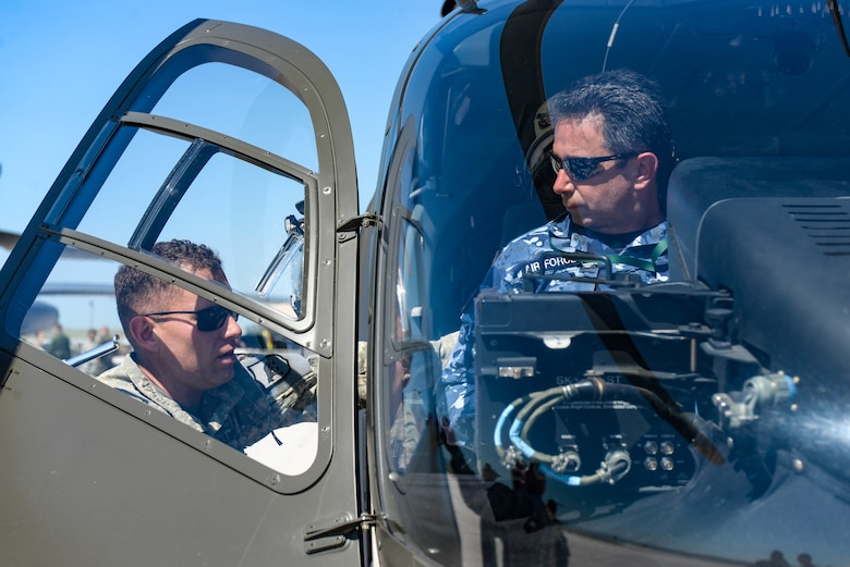 U.S. Army Chief Warrant Officer 2 Rory McCarthy, a pilot assigned to Detachment 1, 1-112th Aviation Regiment, speaks with a foreign defense attaché about the UH-72 Lakota during a tour at Ellsworth Air Force Base, S.D., Sept. 4, 2019. Approximately 45 defense attachés from several different countries visited the base to learn more about the mission of the 28th Bomb Wing and the 89th Attack Squadron.  They toured statics of munitions; a B-1B Lancer, assigned to the 37th Bomb Squadron; and a UH-72, which was provided by the South Dakota National Guard. (U.S. Air Force photo by Tech. Sgt. Jette Carr)