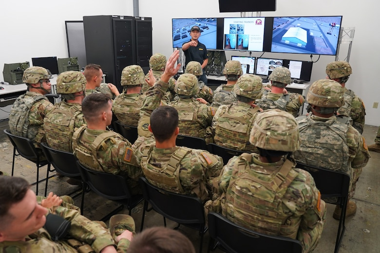 Simulator technician Min Chung gives a briefing to Soldiers assigned to the 98th Support Maintenance Company, 17th Combat Support Sustainment Battalion, U.S. Army Alaska, before they train with the Reconfigurable Vehicle Tactical Trainer on Joint Base Elmendorf-Richardson, Alaska, Sept. 5, 2019. The RVTT provides Soldiers the opportunity to shoot, move, and communicate while mounted in a virtual and controlled environment while taking advantage of customizable exercise scenarios tailored to their unit specific training objectives. (U.S. Air Force photo/Justin Connaher)