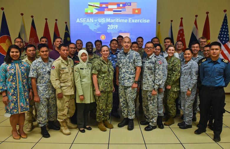 CHANGI NAVAL BASE, Singapore (September 06, 2019) U.S. Navy Sailors and representatives of ASEAN member state maritime forces gather for a photo during the ASEAN-U.S. Maritime Exercise (AUMX). The first ASEAN-U.S. Maritime Exercise, co-led by the U.S. and Royal Thai navies, includes maritime forces from the U.S. and all ten ASEAN member states. AUMX promotes shared commitments to maritime partnerships, security and stability in Southeast Asia.