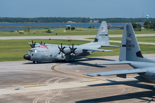A WC-130J Super Hercules aircraft from the 53rd Weather Reconnaissance Squadron, aka Hurricane Hunters, taxis its way to its parking spot after completing its mission into Hurricane Dorian, Sep. 5, 2019 at Keesler Air Force Base, Mississippi. The Hurricane Hunters, have flown 25 missions in support of Dorian. (U.S. Air Force photo by Tech. Sgt. Christopher Carranza)