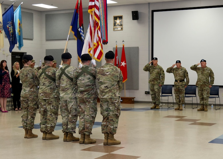 The 99th Readiness Division command team salutes the division's colors during a change of responsibility ceremony held at the 99th Readiness Division headquarters Sept. 7, 2019. The change of responsibility is a transition that is rich with symbolism and heritage, and serves the dual function of recognizing the enlisted service of the departing command sergeant major, and providing official recognition of the change of responsibility as senior noncommissioned officer to the incoming command sergeant major. (U.S. Army Reserve Photo by Sgt. Bethany L. Huff)