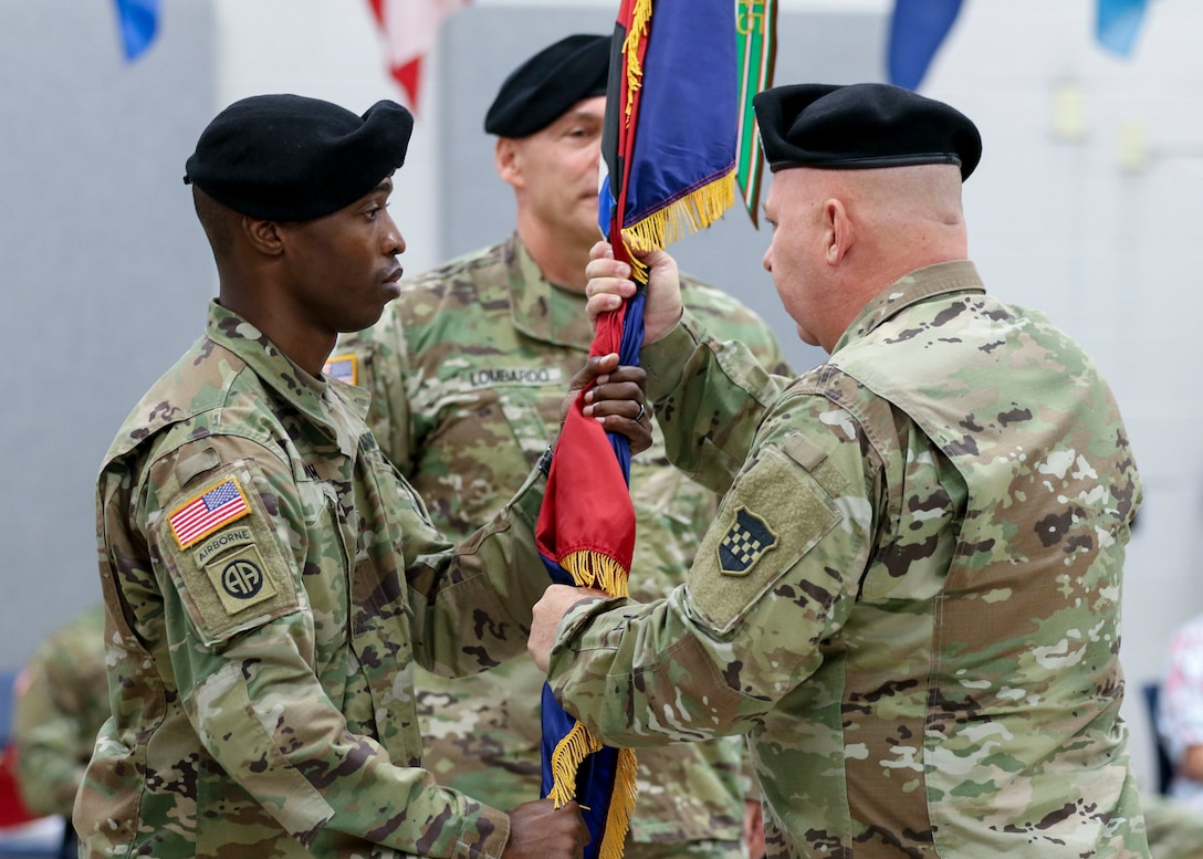Command Sgt. Maj. Jon Zimmerman, the incoming command sergeant major, passes the U.S. Army Reserve's 99th Readiness Division colors to 1st Sgt. Earl Morgan, the 99th Readiness Division Headquarters and Headquarters Company first sergeant, during a change of responsibility ceremony Sept. 7, 2019. The change of responsibility is a transition that is rich with symbolism and heritage, and serves the dual function of recognizing the enlisted service of the departing command sergeant major, and providing official recognition of the change of responsibility as senior noncommissioned officer to the incoming command sergeant major. (U.S. Army Reserve Photo by Sgt. Bethany L. Huff)