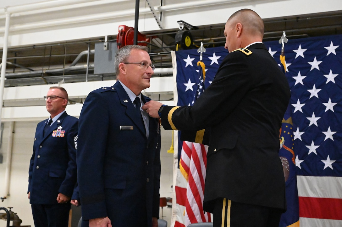 Maj. Gen. Al Dohrmann, the North Dakota adjutant general, right, pins the Federal Distinguished Service Medal onto the uniform of Brig. Gen. Robert Becklund, the North Dakota National Guard Joint Force Headquarters Chief of Staff for Air, during a formal retirement ceremony for Becklund at the North Dakota Air National Guard Base, Fargo, N.D. Sept. 7, 2019. Becklund is retiring after 37 years of military service, including five years as the 119th Wing commander.