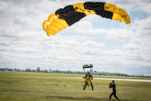 Col. Larry Shaw, 434th Air Refueling Wing commander, completes a tandem parachute jump with Sgt. First Class Jared Zell, U.S. Army Golden Knights, to open up the 2019 Grissom Air & Space Expo, Sept. 7, 2019. The event drew thousands of spectators, and will continue Sept. 8, 2019 as gates open at 8:30 a.m. with flying starting around 11 a.m. and gates closing at 5 p.m. to the free event. (U.S. Air Force photo/Master Sgt. Benjamin Mota)