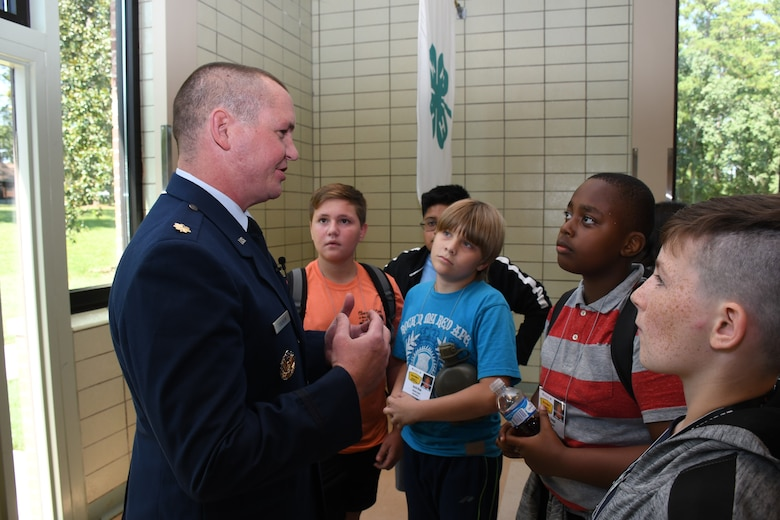 Youth ask questions of Maj. Benjamin Calhoon, 22nd Air Force executive officer, regarding his experience as a space operations officer at Rock Eagle 4-H Center in Eatonton, Ga., Aug 17, 2019. Maj. Calhoon served as capnote speaker for 4-H youth development event and shared opportunities for STEM related careers and space-related technology in the Air Force.