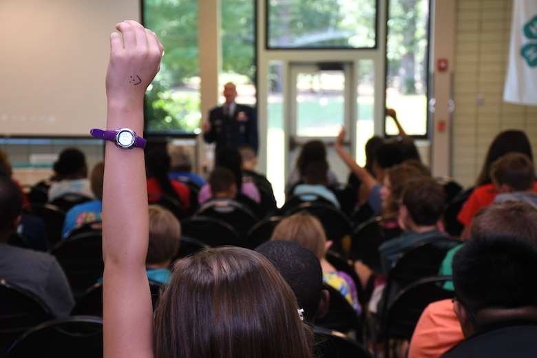 Youth ask questions of Maj. Benjamin Calhoon, 22nd Air Force executive officer, regarding his experience as a space operations officer at Rock Eagle 4-H Center in Eatonton, Ga., Aug 17, 2019. Maj. Calhoon served as capnote speaker for the event and shared opportunities for STEM related careers and space-related technology in the Air Force.