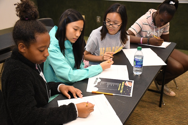 Four middle school female youth practice the engineering process to complete their space-focused mission at Rock Eagle 4-H Center in Eatonton, Ga., Aug 17, 2019.  The Air Force and space focused programming allowed youth to question and hear from Air Force personnel.    (U.S. Air Force photo by 1st Lt. Casey D. Mull)