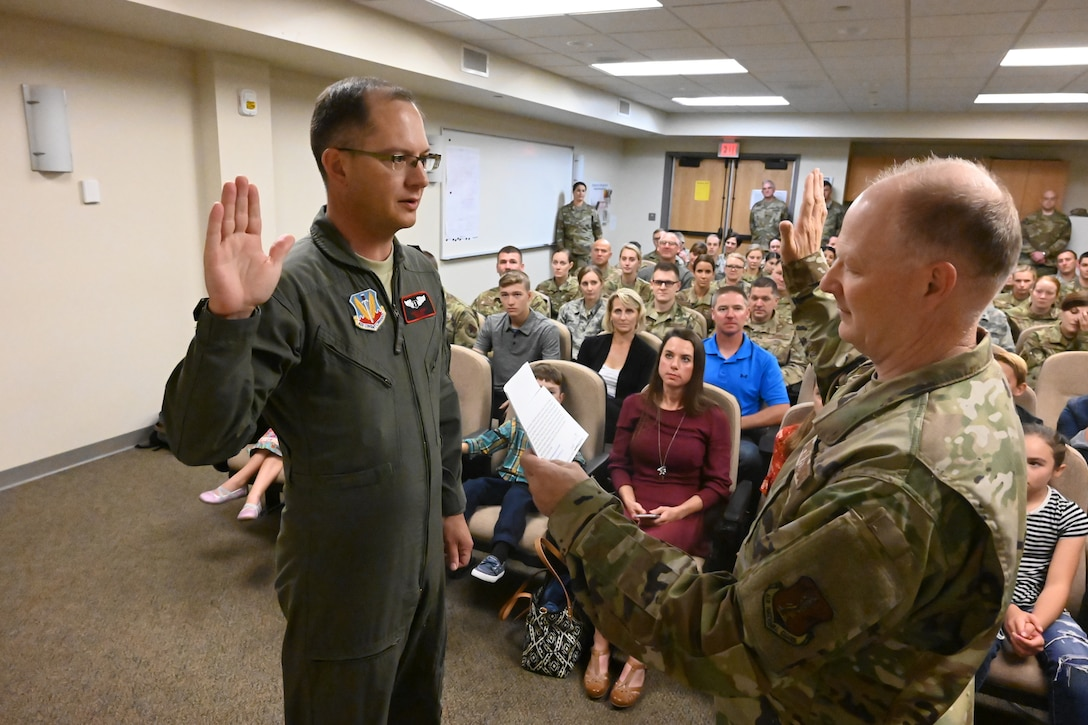 Col. Bryan Delage, the North Dakota National Guard state air surgeon, right, swears in Col. Joseph Wyatt to his promotion rank of colonel as Wyatt assumes the duties of the 119th Medical Group commander at the North Dakota Air National Guard Base, Fargo, N.D., Sept. 7, 2019.
