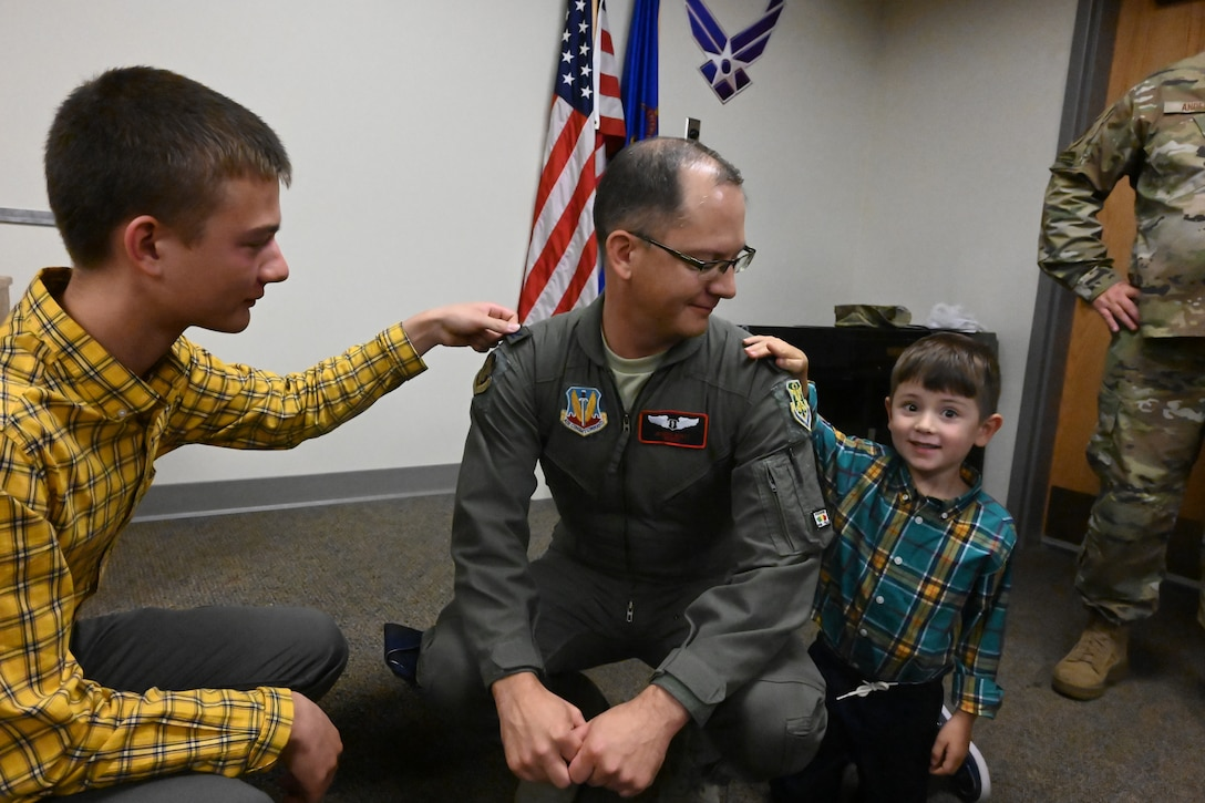 Col. Joseph Wyatt gets his promotion rank of colonel placed onto his uniform by his sons during a promotion ceremony at the North Dakota Air National Guard Base, Fargo, N.D., Sept. 7, 2019.