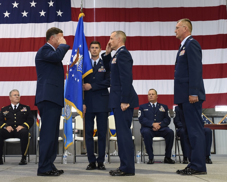 Col. Mark R. Morrell, 114th Fighter Wing incoming commander, salutes Brig. Gen. Russ A. Walz, Assistant Adjutant General for air, South Dakota Air National Guard, during the 114th Fighter Wing Change of Command Ceremony at Joe Foss Field, S.D. Sept. 7, 2019.