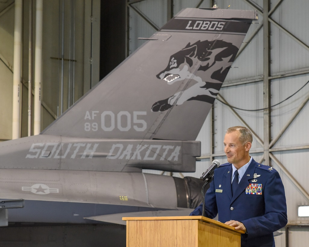 Col. Mark R. Morrell addresses 114th Fighter Wing Airmen, family and friends during a commander's call after he assumed his new role as the 114th FW commander at Joe Foss Field, Sept. 7.