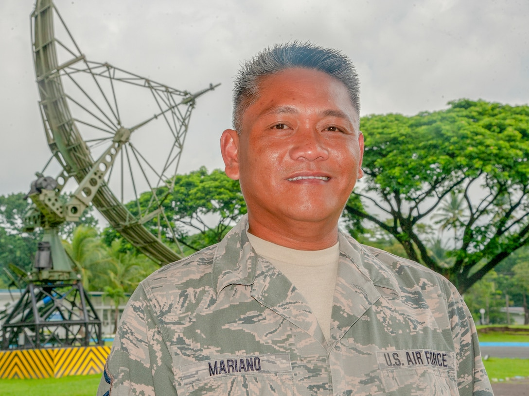Master Sgt. Eugene Mariano, 298th Support Squadron radar maintenance technician poses for a picture in front of a Philippine Air Force radar monument, Aug. 20, 2019, Clark Air Base, Philippines.