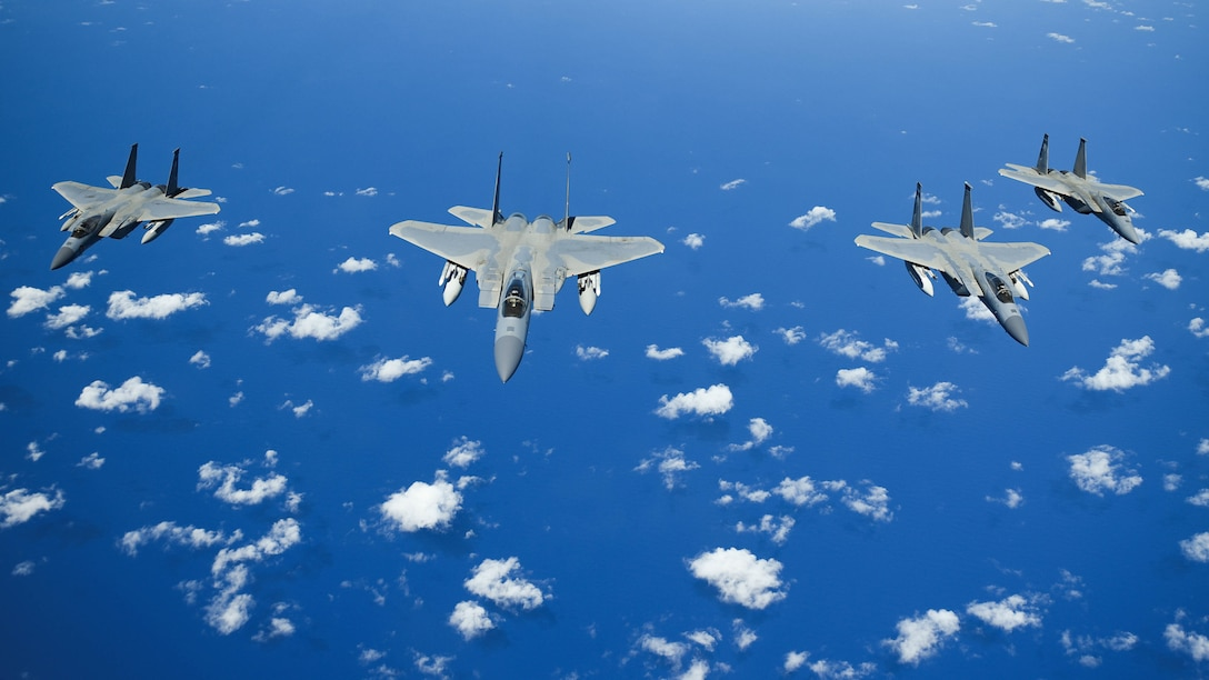 United States Air Force F-15 Eagles from the 173rd Fighter Wing out of Kingsley Field in Klamath Falls, Oregon, fly in formation over the Pacific Ocean during the Sentry Aloha exercise at Joint Base Pearl Harbor-Hickam, August 27, 2019.