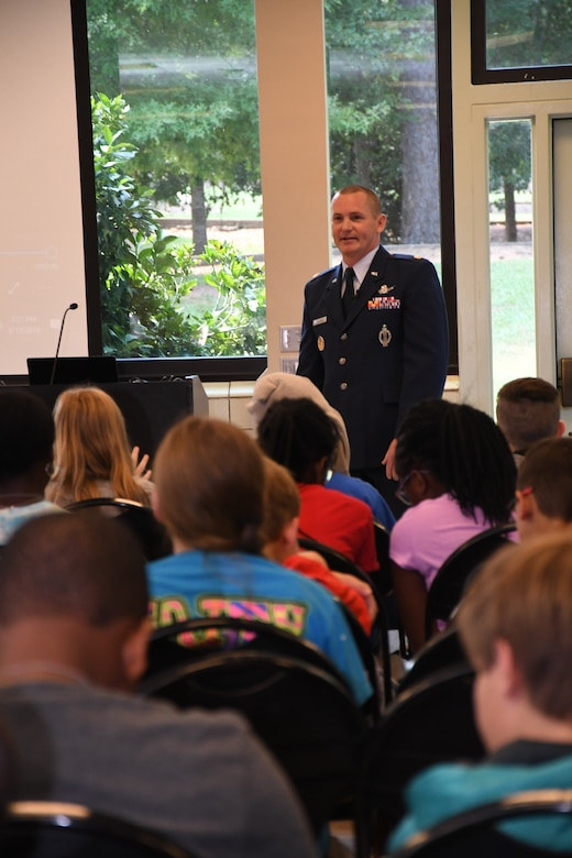 Maj. Benjamin Calhoon, 22nd Air Force executive officer, shares his Air Force experiences to middle school youth at Rock Eagle 4-H Center in Eatonton, Ga., Aug 17, 2019. Maj. Calhoon served as capnote speaker for the event and shared opportunities for STEM related careers in the Air Force.