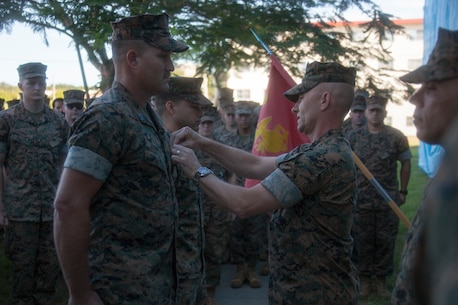 Gunnery Sgt. Jared D. Hammond, a ground electronics systems maintenance technician with the 31st Marine Expeditionary Unit, receives a Navy and Marine Corps Achievement Medal from Col. Robert B. Brodie, commanding officer of the 31st MEU, during a breakfast potluck, Camp Hansen, Okinawa, Japan, Aug. 30, 2019. The 31st MEU, the Marine Corps' only continuously forward-deployed MEU, provides a flexible and lethal force ready to perform a wide range of military operations as the premier crisis response force in the Indo-Pacific region. (U.S. Marine Corps official photo by Lance Cpl. Kevan Dunlop)
