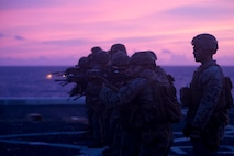 Marines with Fox Company, Battalion Landing Team, 2nd Battalion, 1st Marines, 31st Marine Expeditionary Unit, fire M4A1 service rifles during a live-fire range aboard the amphibious transport dock USS Green Bay (LPD 20). Green Bay, part of the Wasp Amphibious Ready Group, with embarked 31st MEU, is operating in the Indo-Pacific region to enhance interoperability with partners and serve as a ready-response force for any type of contingency. (U.S. Marine Corps photo by Lance Cpl. Kyle P. Bunyi)