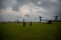 Marines with Echo Company, Battalion Landing Team, 2nd Battalion, 1st Marines, 31st Marine Expeditionary Unit, exit MV-22B Osprey tiltrotor aircraft after conducting a simulated long-range raid, Camp Hansen, Okinawa, Japan, Aug. 14, 2019. The 31st MEU and Amphibious Squadron 11, aboard Wasp Amphibious Ready Group ships, are conducting a series of sequential operations which simulate naval expeditionary combined-arms maneuver from amphibious assets to shore, utilizing Marine Air-Ground Task Force capabilities integrated across all warfighting domains. (U.S. Marine Corps photo by Lance Cpl. Kenny Nunez Bigay)