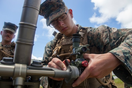 Lance Cpl. Preston Wilkins, a mortarman with Battalion Landing Team, 2nd Battalion, 1st Marines, 31st Marine Expeditionary Unit, sets up an M252 81 mm mortar system during fire and maneuver training, Camp Hansen, Okinawa, Japan, Aug. 28, 2019. The 31st MEU, the Marine Corps' only continuously forward-deployed MEU, provides a flexible and lethal force ready to perform a wide range of military operations as the premier crisis response force in the Indo-Pacific region. (U.S. Marine Corps official photo by Lance Cpl. Kevan Dunlop)