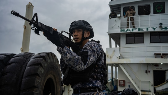 A member of the Philippine Coast Guard holds security during an opposed-boarding drill as part of Baker Piston 19-2, Puerto Princesa, Palawan, Philippines, August 29, 2019. During Baker Piston 19-2, the Marines of the 31st Marine Expeditionary Unit's Maritime Raid Force are exchanging Visit, Board, Search and Seizure techniques and procedures with members of the Philippine National Police Maritime Group and PCG around the island of Palawan. The 31st MEU, the Marine Corps' only continuously forward-deployed MEU, provides a flexible and lethal force ready to perform a wide range of military operations as the premier crisis response force in the Indo-Pacific region. (Official U.S. Marine Corps photo by Cpl. Isaac Cantrell)