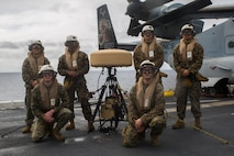 Marines from the Marine Air Traffic Control Mobile Team stand alongside their Tactical Aid to Navigation device, which helps them guide incoming aircraft into the landing zone. Being able to rapidly set up and maintain airstrips and helipads in a deployed environment is one of the many capabilities that Detachment 18 brings to the 31st MEU.