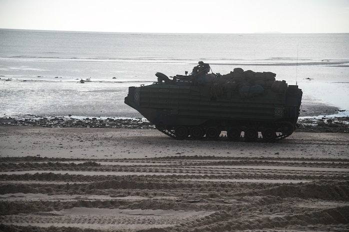 An Assault Amphibious Vehicle with Battalion Landing Team, 2nd Battalion, 1st Marines, 31st Marine Expeditionary Unit, patrols the coast after a simulated raid on Townshend Island, Queensland Australia, July 1, 2019. The 31st MEU, the Marine Corps' only continuously forward-deployed MEU, provides a flexible and lethal force ready to perform a wide range of military operations as the premier crisis response force in the Indo-Pacific region. (U.S. Marine Corps photo by Lance Cpl. Kyle P. Bunyi)