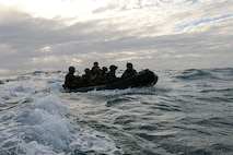Marines with Battalion Landing Team, 2nd Battalion, 1st Marines, 31st Marine Expeditionary Unit, ride ashore in a Combat Rubber Raiding Craft during a boat raid exercise in the Coral Sea, July 3, 2019. The Marines launched from the amphibious dock landing ship USS Ashland (LSD 48), part of the Wasp Amphibious Ready Group, with embarked 31st MEU, while operating in the Indo-Pacific region to enhance interoperability with partners and serve as a ready-response force for any type of contingency, while simultaneously providing a flexible and lethal crisis response force ready to perform a wide range of military operations. (Official U.S. Marine Corps photo by Cpl. Brennan Priest)
